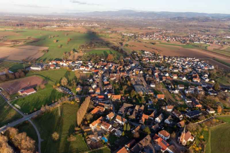 Village view on the edge of agricultural fields and land and sporting fields in the district Buehl in Offenburg in the state Baden-Wurttemberg, Germany