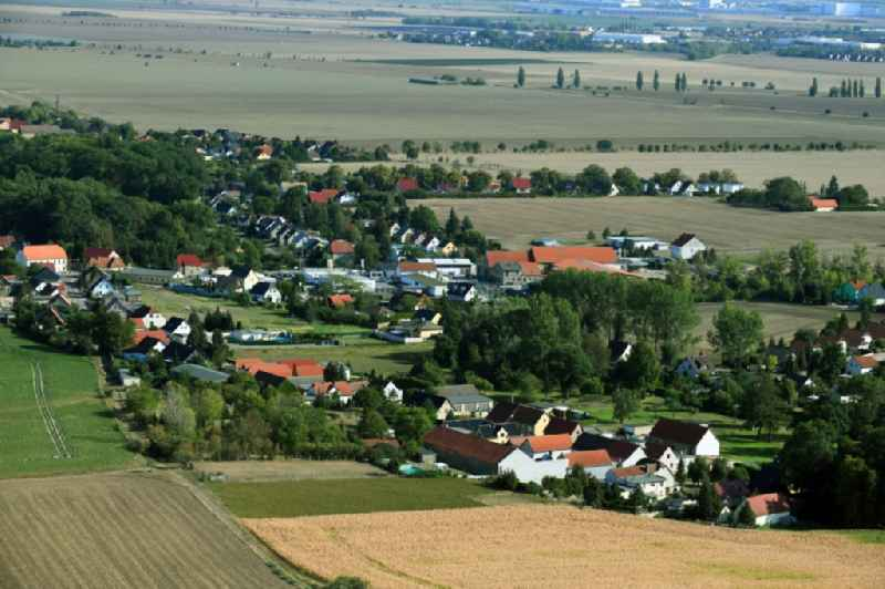 Agricultural land and field borders surround the settlement area of the village in Oppin in the state Saxony-Anhalt, Germany