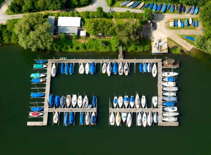 Boats and Camping in the lake Kollersee in Otterstadt in the state of Rhineland-Palatinate. The village is characterised by lakes and small ponds and various small island which form the recreational area. Shipping, swimming and hiking are typical tourism offerings. The village belongs to the community of Waldsee and is located on the Autobahn A61 and the river Rhine.