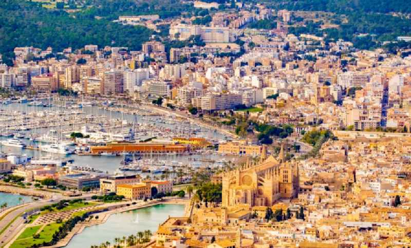 Church building of the cathedral on Placa de la Seu in the old town - center with a view of the harbor in Palma de Mallorca on the Balearic island of Mallorca, Spain