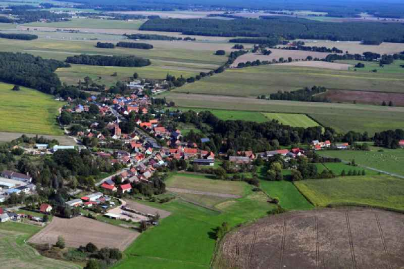 Agricultural land and field borders surround the settlement area of the village in Papenbruch in the state Brandenburg, Germany