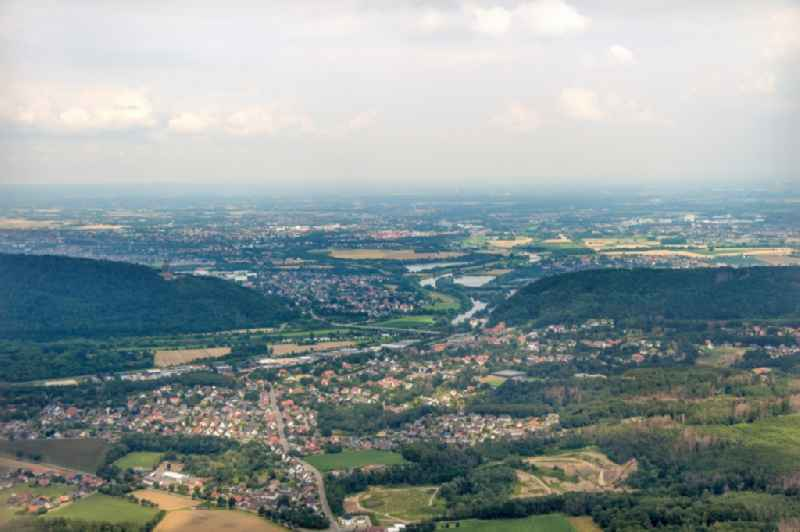 Location view of the streets and houses of residential areas in the valley landscape surrounded by mountains of the Wiehengebirge along the Findelstrasse - B482 in the district Hausberge in Porta Westfalica in the state North Rhine-Westphalia, Germany