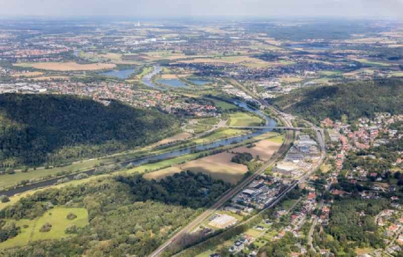 Location view of the streets and houses of residential areas in the valley landscape surrounded by mountains in the district Holzhausen in Porta Westfalica in the state North Rhine-Westphalia, Germany