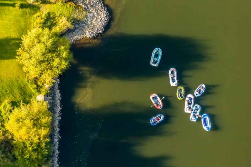 Sport Boat - Dinghy in motion on the water surface in the river of Weser in the district Holtrup in Porta Westfalica in the state North Rhine-Westphalia, Germany