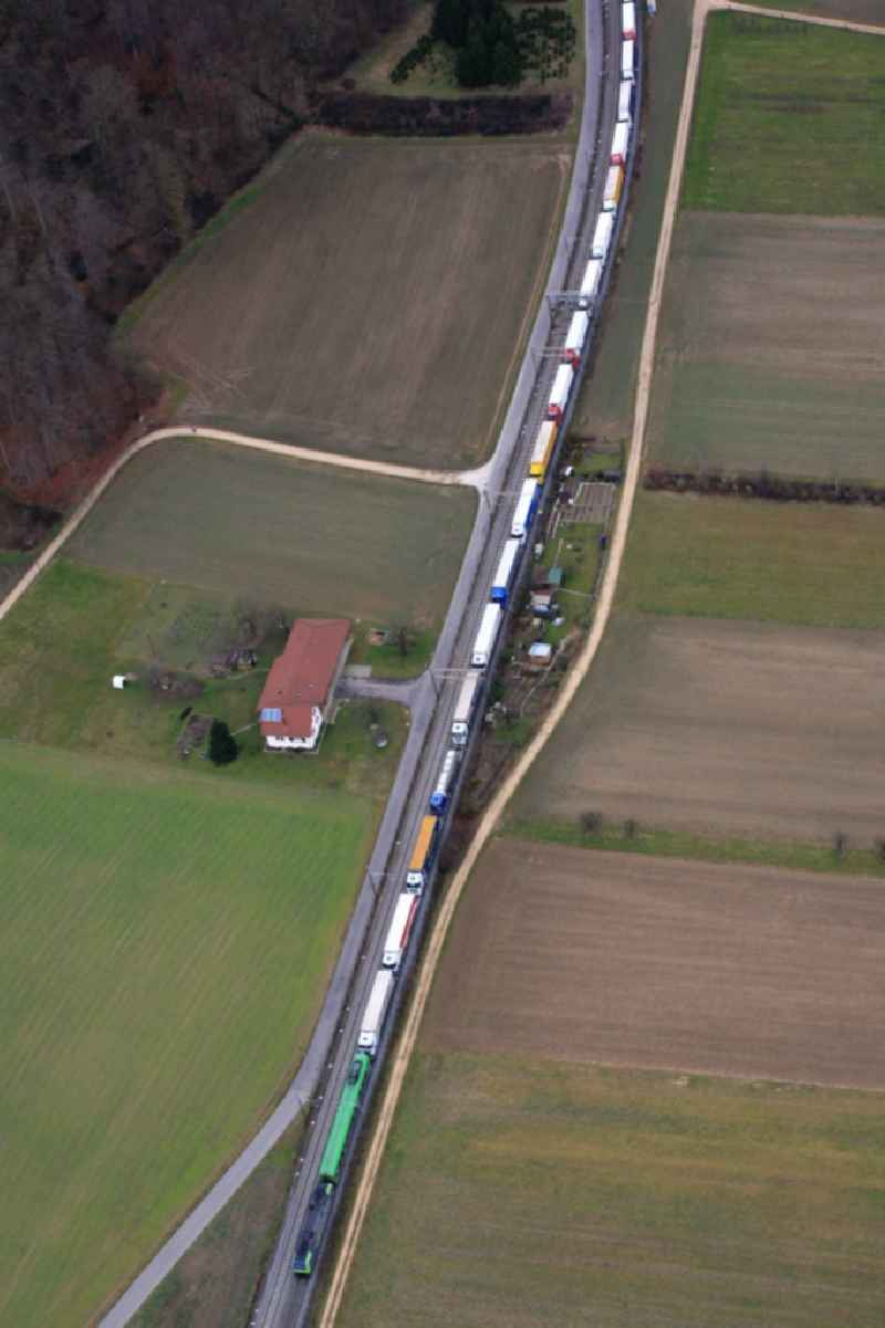 Freight train with loaded trucks in Pratteln in Switzerland. The Alptransit NEAT is planning to expand the railways and to shift freight traffic for  crossing the Alps from road to rail