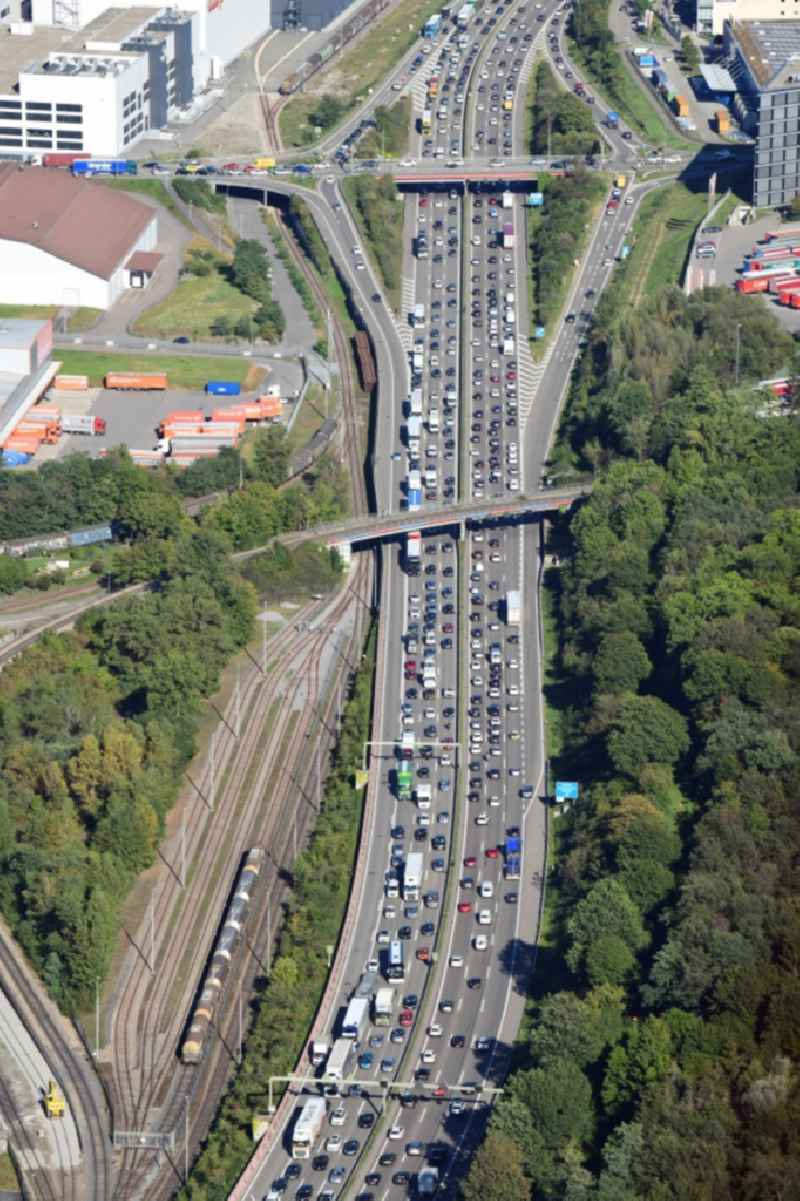 Highway congestion along the route of the lanes of the swiss motorway A2 / A3 in Pratteln next to Basle in the canton Basel-Landschaft, Switzerland.