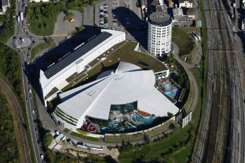 Building, pools and water slide of Water World Aquabasilea in Pratteln in the canton Basel-Landschaft, Switzerland. The round building in the neighborhood is the corporate headquarter of Clariant AG.
