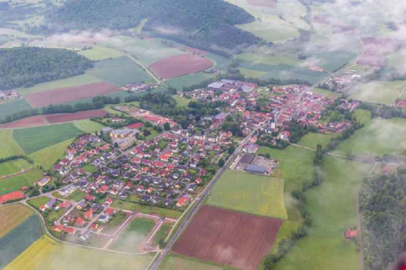 Village - view on the edge of agricultural fields and farmland in the district Untersteinbach in Rauhenebrach in the state Bavaria, Germany.