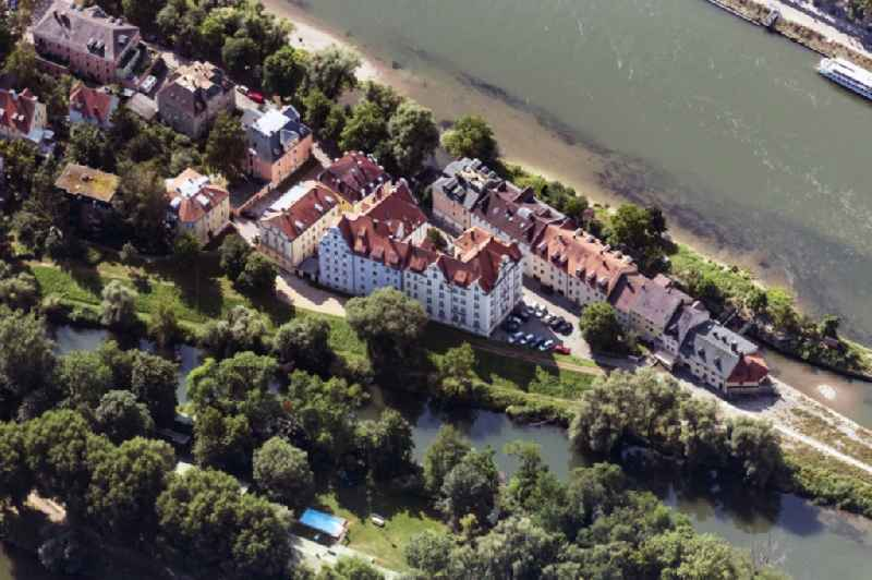 Residential area of a multi-family house settlement on the bank and river of the river Danube in Regensburg in the state Bavaria, Germany