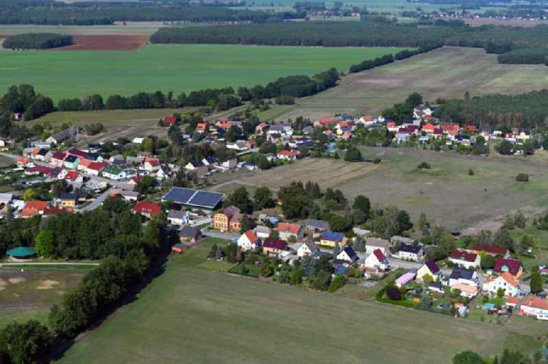 Village view on the edge of agricultural fields and land in Rehagen in the state Brandenburg, Germany
