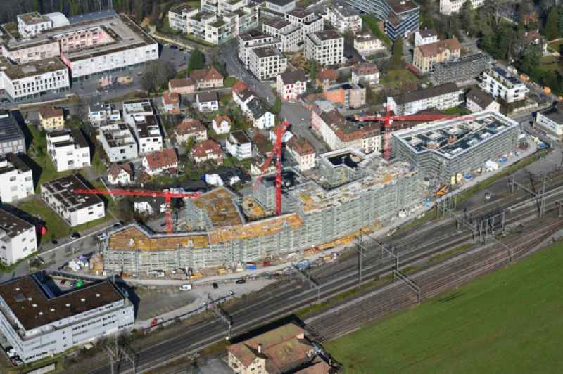 Construction site for City Quarters Building ' Furnierwerk ' with housing and commercial units and the expansion of Salmenpark at the river Rhine in Rheinfelden, canton Aargau, Switzerland. Further information at: Implenia AG,  Intercity AG,  Luca Selva AG,  WMM Ingenieure AG.