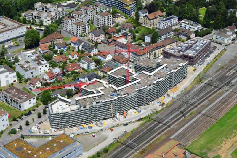 Construction site for City Quarters Building ' Furnierwerk ' with housing and commercial units and the expansion of Salmenpark at the river Rhine in Rheinfelden, canton Aargau, Switzerland