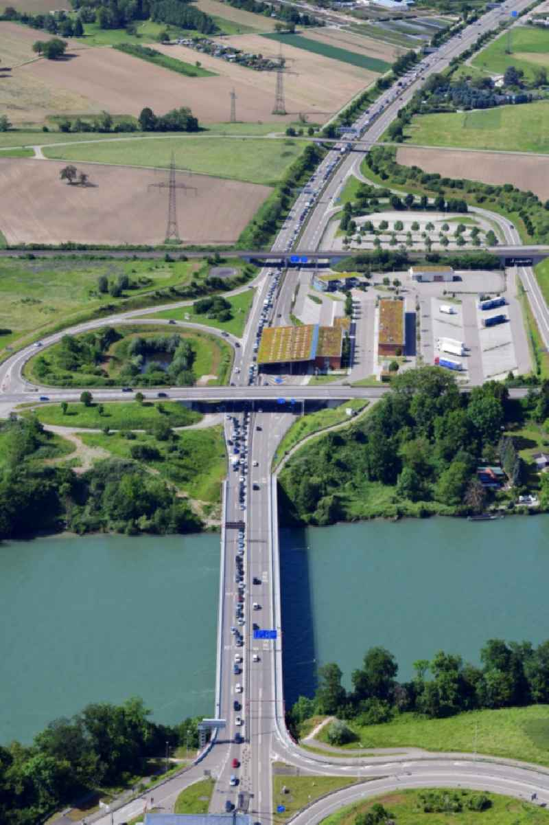 Highway congestion along the route of the lanes of the motorway A861 over the Rhine bridge at the border and customs buildings of Switzerland and Germany in Rheinfelden in the canton Aargau, Switzerland and Germany, Baden-Wurttemberg.