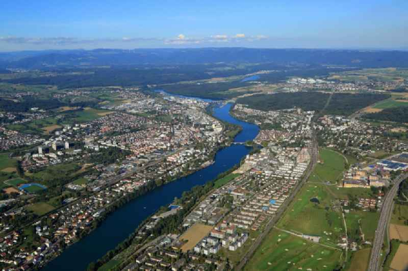 City centers on the banks of river course Rhine in Rheinfelden (Baden) in the state Baden-Wurttemberg, Germany, (left) and Rheinfelden, Switzerland, (right).