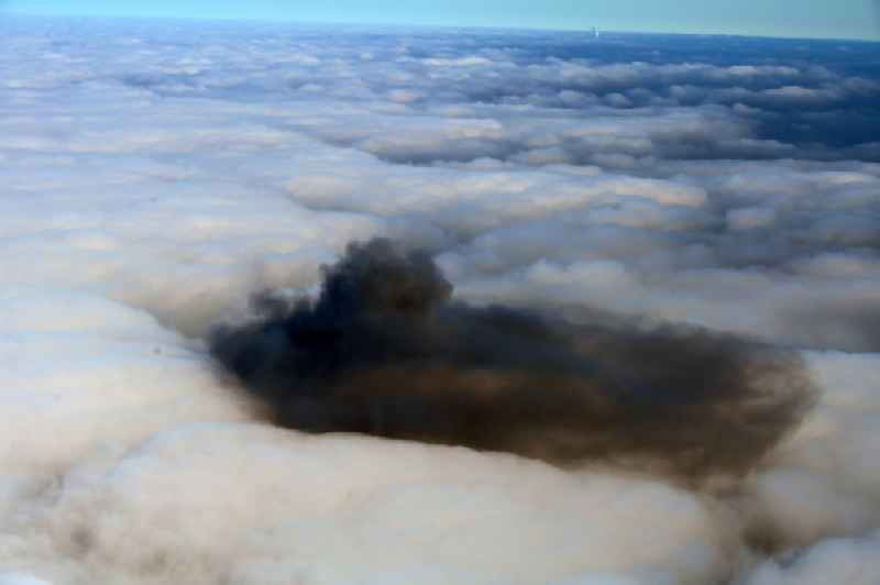 Weather situation with cloud formation and black combustion residues in a closed covering layer of high fog over Riesa in the state Saxony, Germany