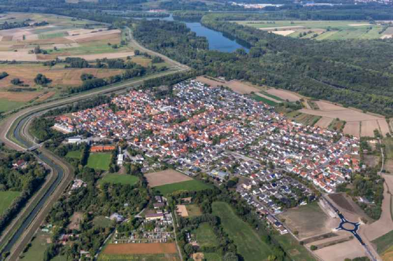 Village view on the edge of agricultural fields and land in Russheim in the state Baden-Wuerttemberg, Germany