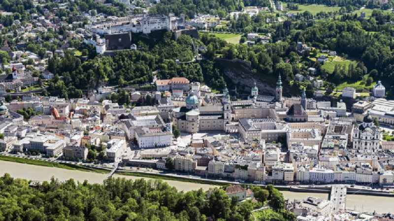 City center in the downtown area on the banks of river course of Salzach in Salzburg in Austria