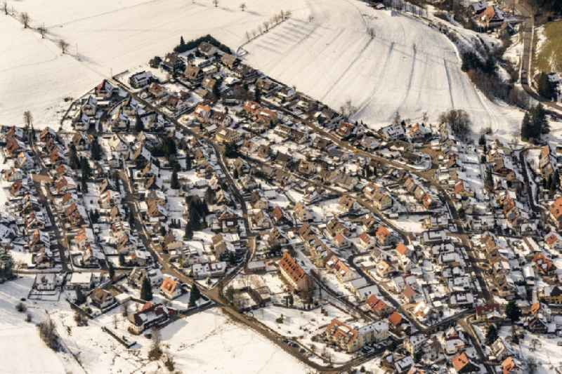 Wintry snowy residential area construction site of a mixed development with multi-family houses and single-family houses- New building at the in Sankt Peter in the state Baden-Wurttemberg, Germany
