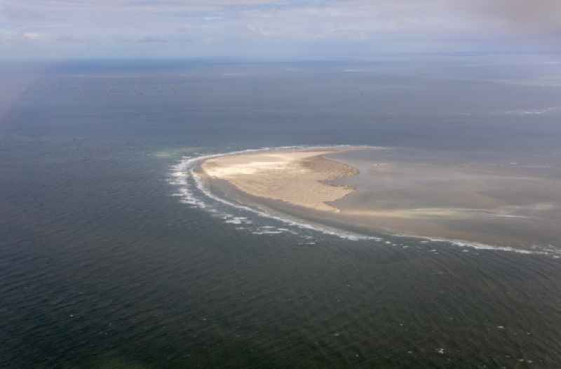 Sandbank- land area by flow under the sea water surface of North Sea in Schilling in the state Lower Saxony, Germany