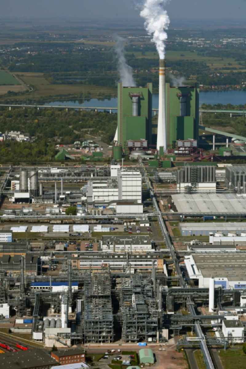 Technical facilities in the industrial area with refinery systems and the exhaust towers of the thermal power station in the district Hohenweiden in Schkopau in the state Saxony-Anhalt, Germany