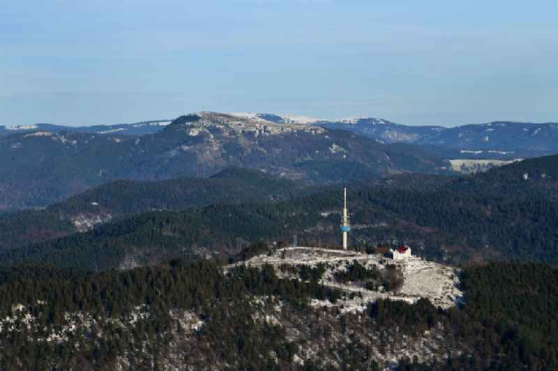 Wintry snowy mountainous landscape with summit of Hochblauen or Blauen in the Black Forest in Schliengen in the state Baden-Wurttemberg, Germany. Further information at: DFMG Deutsche Funkturm GmbH.
