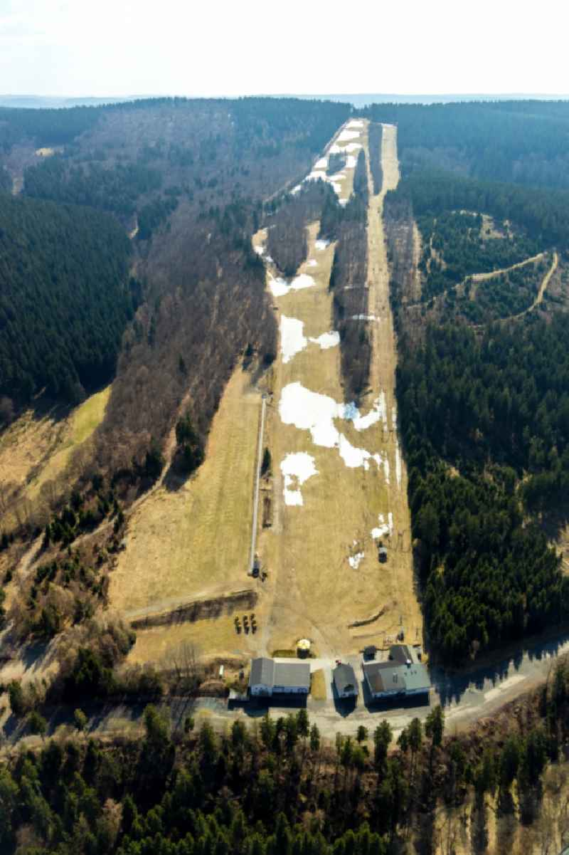 Mountain slope with downhill ski slope and cable car - lift Hunaulift in Schmallenberg in the state North Rhine-Westphalia, Germany