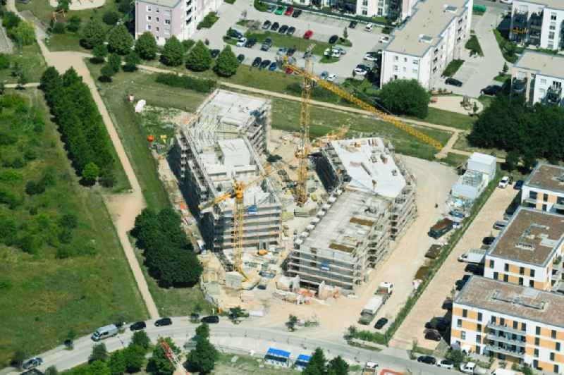 Construction site for the multi-family residential building ' Theodor-Fontane-Hoefe ' on Theodor-Fontane-Allee - Bayangolpark in Schoenefeld in the state Brandenburg, Germany