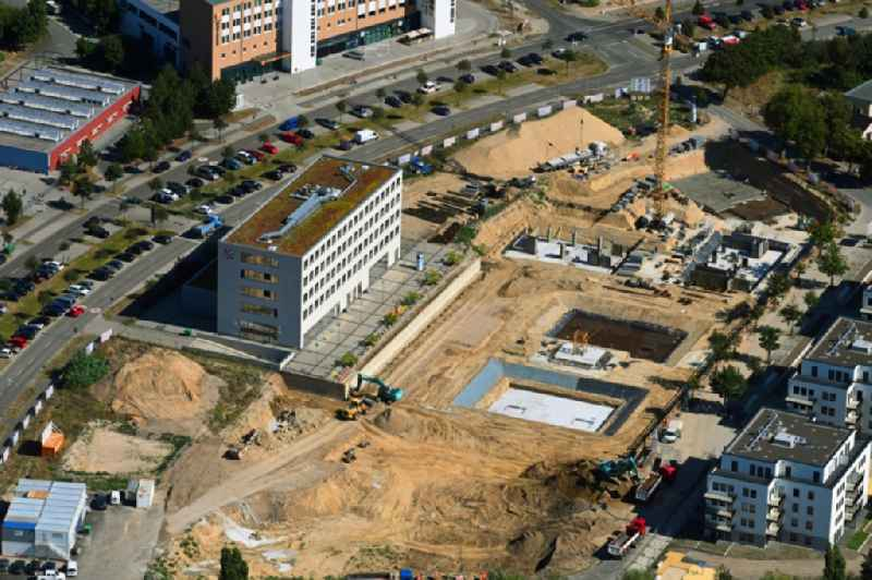 Construction site to build a new multi-family residential complex ' Neue Mitte ' on Hans-Grade-Allee - Grossziethener Weg - Am Schoenefeld in Schoenefeld in the state Brandenburg, Germany