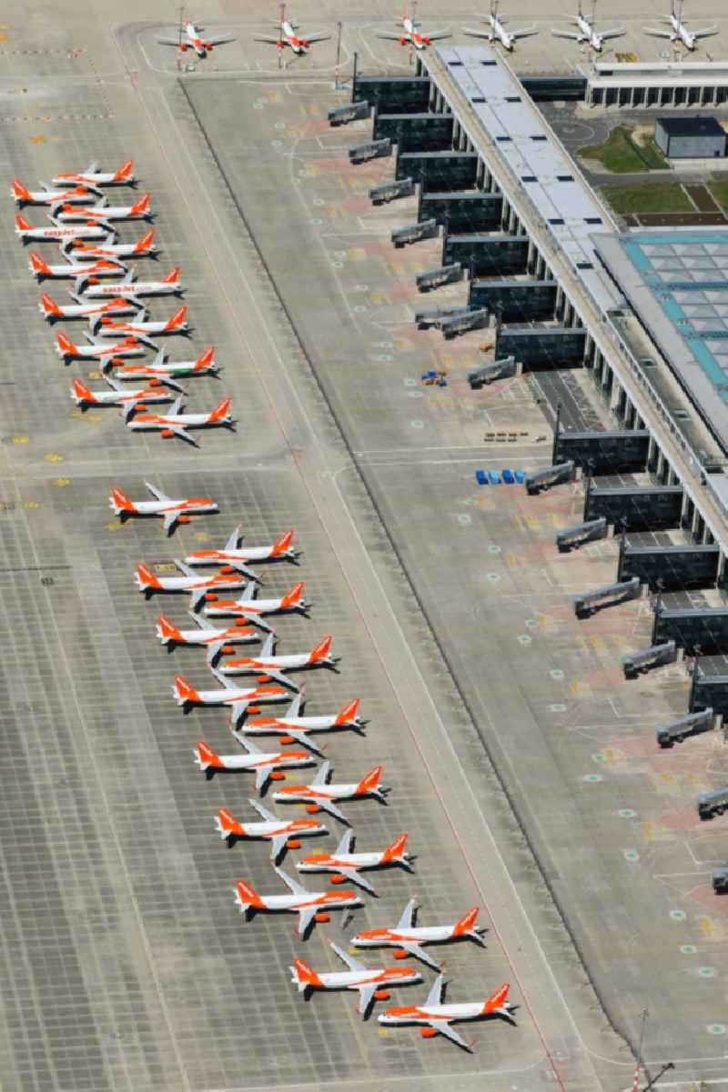 Decommissioned due to crisis passenger airplanes of the airline easyJet in parking position - parking area at the airport in Schoenefeld in the state Brandenburg, Germany