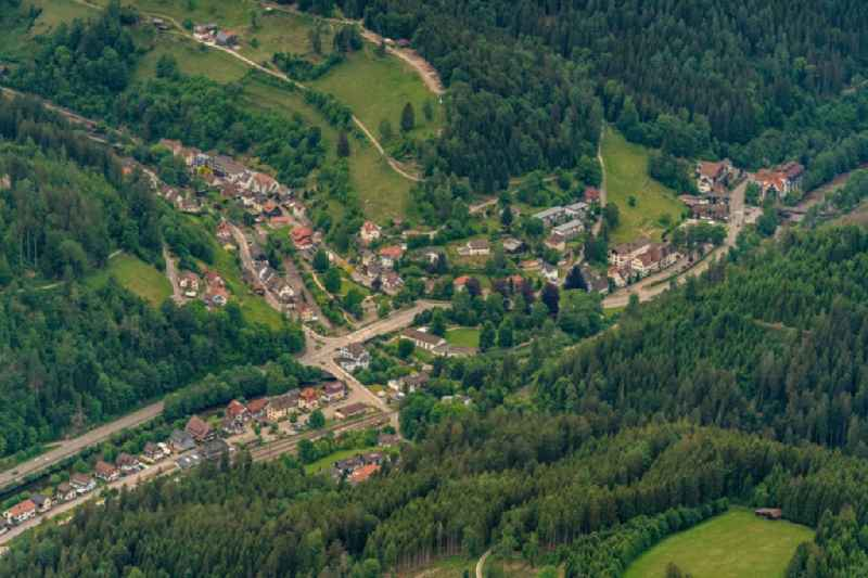 Location view of the streets and houses of residential areas in the valley landscape surrounded by mountains in Schoenmuenzach in the state Baden-Wuerttemberg, Germany