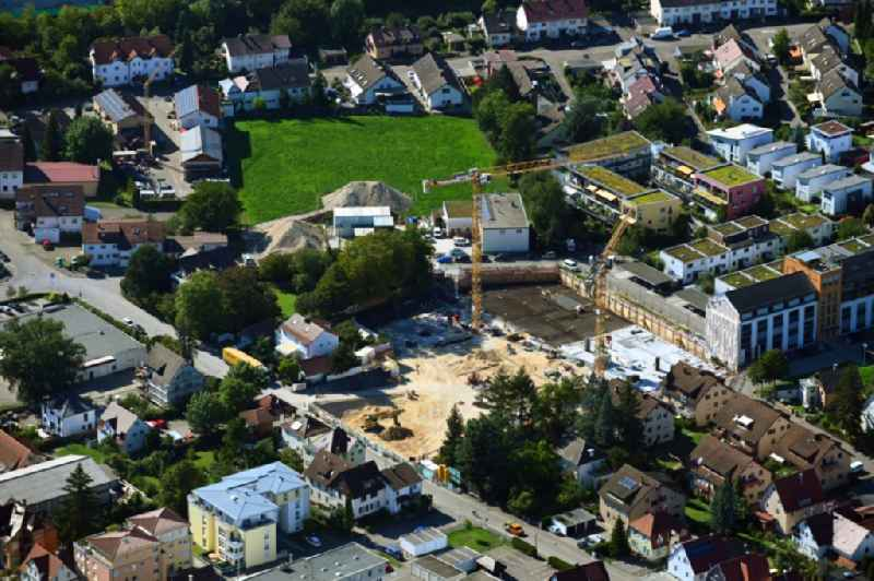 Construction site to build a new multi-family residential complex ' Muehlenviertel ' in Schorndorf in the state Baden-Wuerttemberg, Germany
