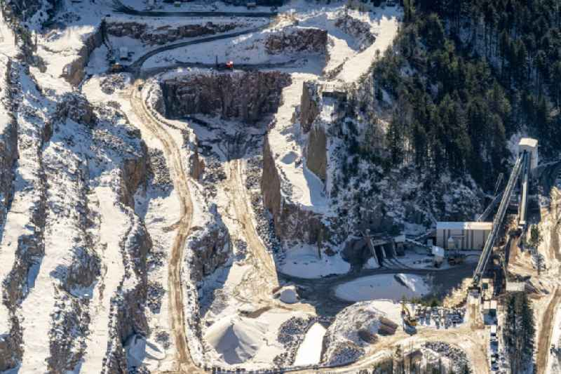 Wintry snowy quarry for the mining and handling of Granit in Seebach in the state Baden-Wurttemberg, Germany