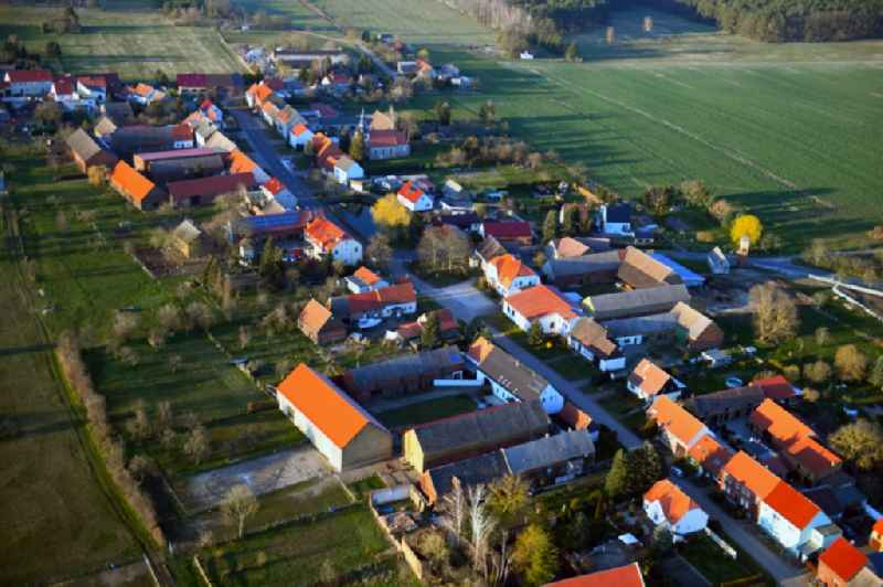 Agricultural land and field borders surround the settlement area of the village in Senst in the state Saxony-Anhalt, Germany