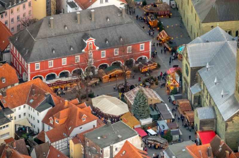 Christmassy market event grounds and sale huts and booths on Petrikirchhof in Soest in the state North Rhine-Westphalia, Germany.