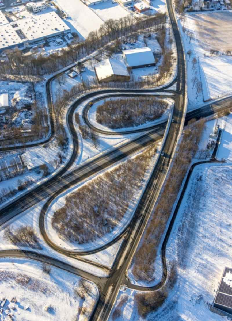 Wintry snowy routing and traffic lanes during the exit federal highway B475 on Opmuender Weg in Soest in the state North Rhine-Westphalia, Germany