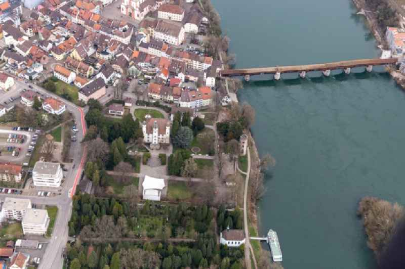 City center with old town and Castle Schoenau and the historic bridge to Switzerland crossing the river Rhine in Bad Saeckingen in the state Baden-Wurttemberg, Germany