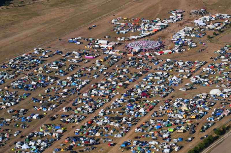 Participants in the Antaris Projekt music festival on the event concert area on airfield in Stoelln in the state Brandenburg, Germany