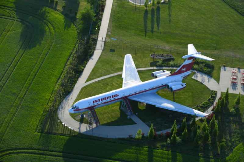 Discharged passenger aircraft IL-62 of the GDR - airline INTERFLUG ' Lady Agnes ' on a parking area in Stoelln in the federal state Brandenburg, Germany