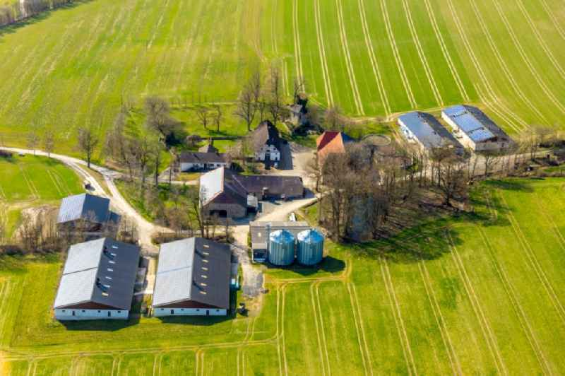 Barn building on the edge of agricultural fields and farmland with stables on Hof Zum Broich in the district Hellefeld in Sundern (Sauerland) in the state North Rhine-Westphalia, Germany