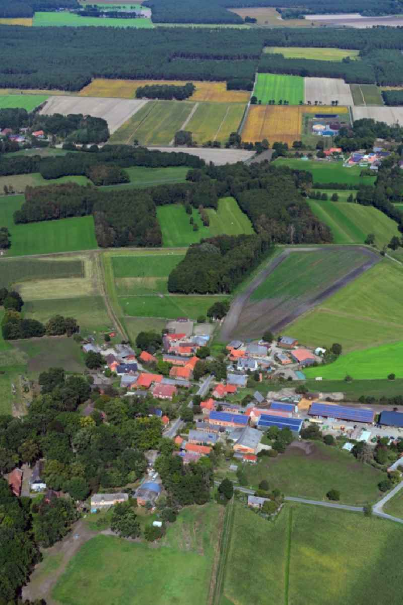 Village - view on the edge of agricultural fields and farmland in Teichlosen in the state Lower Saxony, Germany