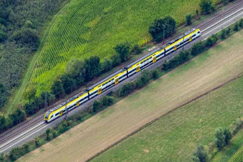 Ride a train on the track Rheintalbahn in Teningen in the state Baden-Wuerttemberg, Germany