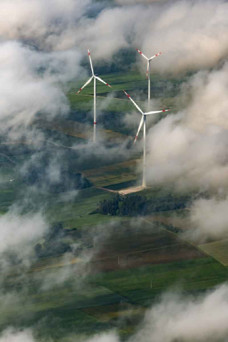 Weather-induced wind energy installations embedded in a cloud layer in Titting in the state Bavaria, Germany.