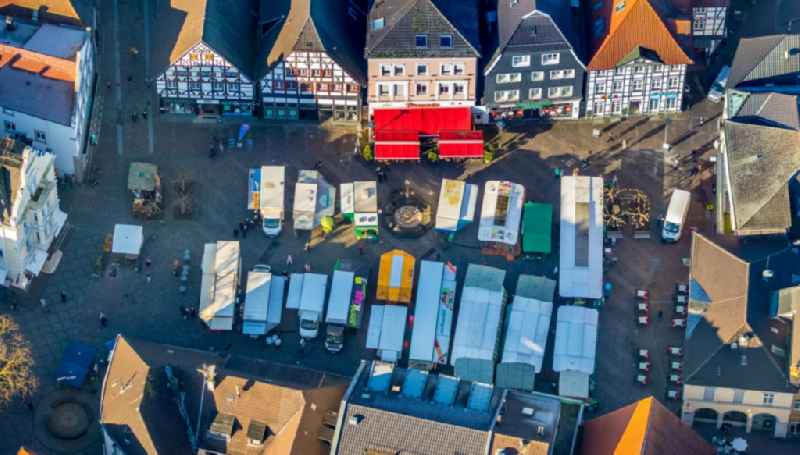 Sale and food stands and trade stalls in the market place of 'Marktplatz of Stadt Unna' on Markt in Unna in the state North Rhine-Westphalia, Germany