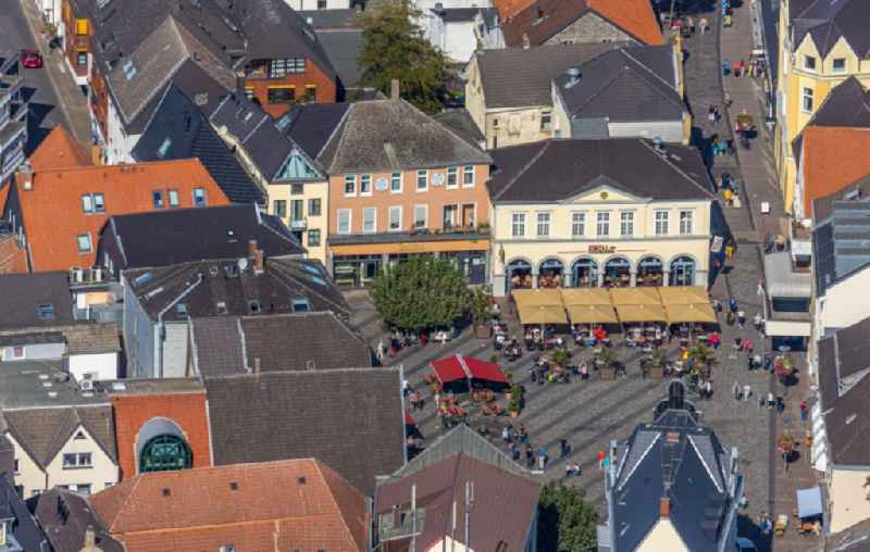 Tables and benches of open-air restaurants on Markt in Unna in the state North Rhine-Westphalia, Germany