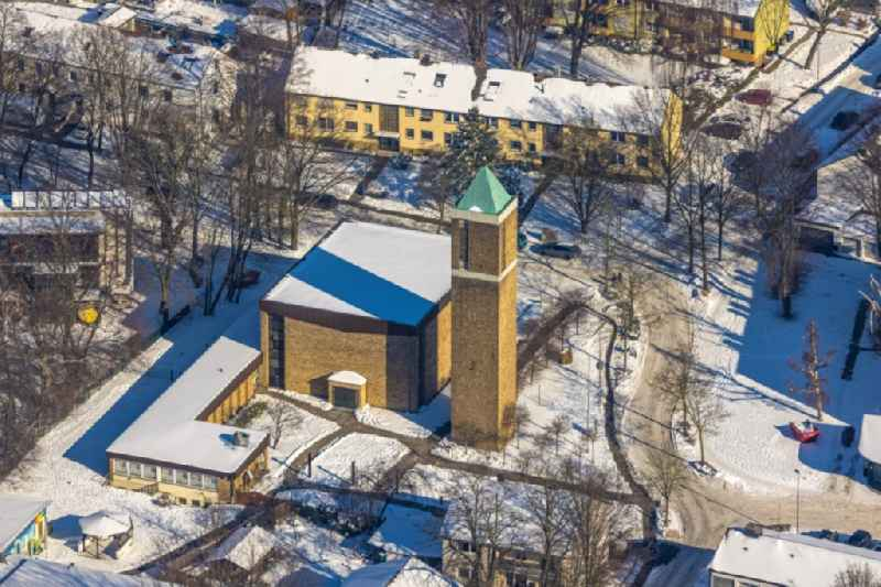 Wintry snowy church building of the 'Paul-Gerhardt-Kirche' on Fliederstrasse in Unna at Ruhrgebiet in the state North Rhine-Westphalia, Germany