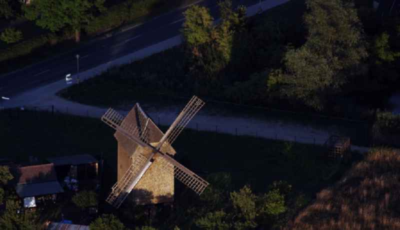 Historic windmill on a farm homestead on the edge of cultivated fields in Vehlefanz in the state Brandenburg, Germany