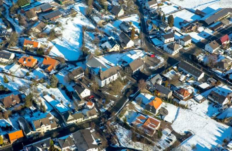 Wintey snowy Town View of the streets and houses of the residential areas in Vosswinkel in the state North Rhine-Westphalia