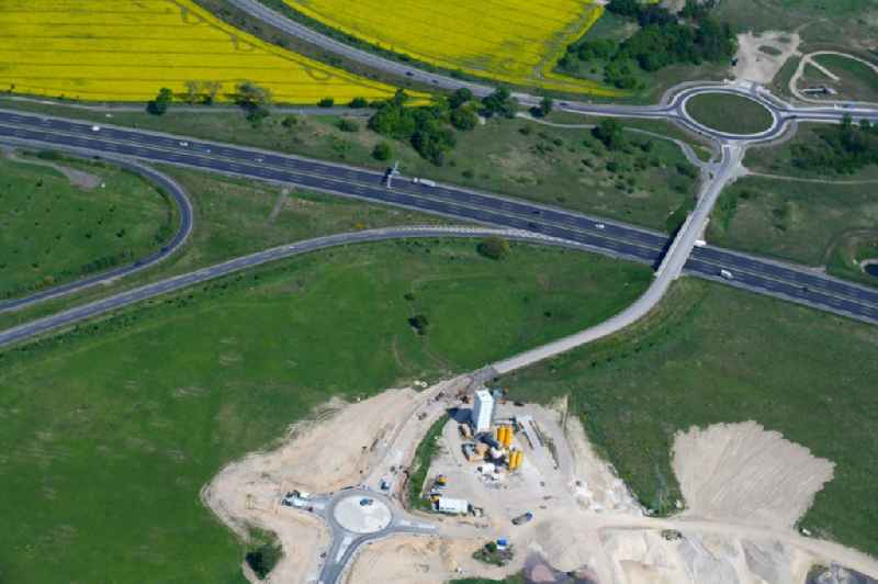 New construction of the road at the roundabout - road Hugo-Eckner-Allee about the tracking of federal motorway of BAB A113 in Waltersdorf in the state Brandenburg, Germany