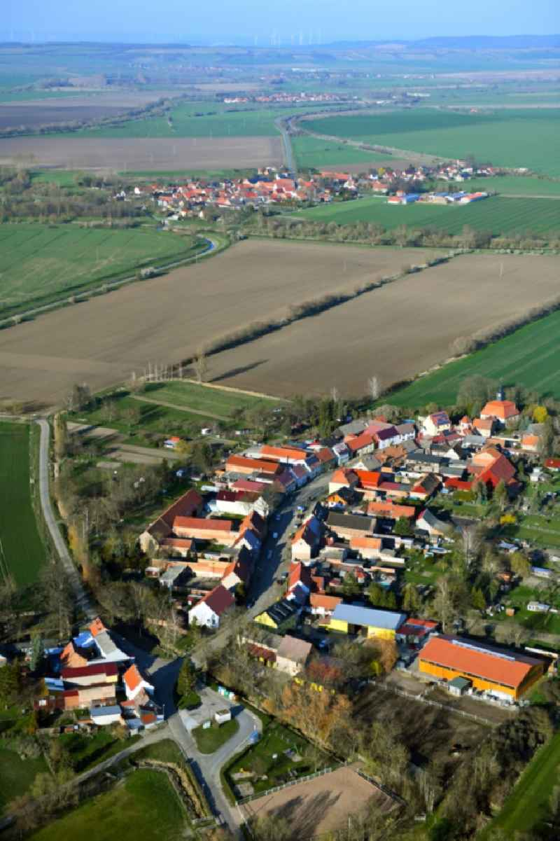 Agricultural land and field borders surround the settlement area of the village in Waltersdorf in the state Thuringia, Germany