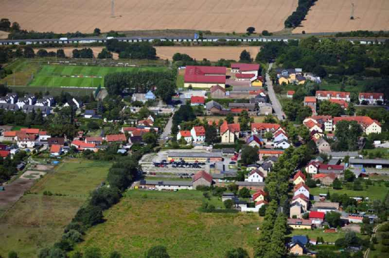 Village view on the edge of agricultural fields and land in Waltersdorf in the state Brandenburg, Germany